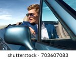 handsome man in the car ... | Shutterstock . vector #703607083