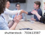 business partner shake hands on ... | Shutterstock . vector #703613587