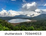 buyan lake. bali. indonesia | Shutterstock . vector #703644013