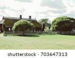 an ancient estate where the... | Shutterstock . vector #703647313