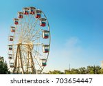 ferris wheel with a secure... | Shutterstock . vector #703654447