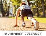start to jogging in park....   Shutterstock . vector #703670377