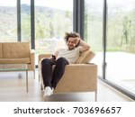 handsome casual young man using ...   Shutterstock . vector #703696657