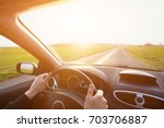 driving car  hands of driver on ... | Shutterstock . vector #703706887