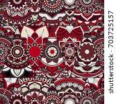 seamless mandalas pattern.... | Shutterstock .eps vector #703725157