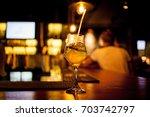 fresh tall glass of tropical... | Shutterstock . vector #703742797