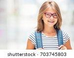 schoolgirl with bag  backpack.... | Shutterstock . vector #703745803