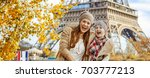 autumn getaways in paris with...   Shutterstock . vector #703777213