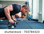 fit young man in sportswear... | Shutterstock . vector #703784323