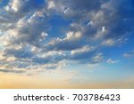 blue clouds leaving into the... | Shutterstock . vector #703786423
