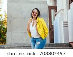 pretty young woman wearing... | Shutterstock . vector #703802497