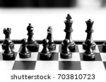 black chess pieces on a chess... | Shutterstock . vector #703810723
