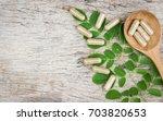 herbal medicine in capsules... | Shutterstock . vector #703820653