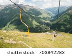 chairlift in the mountains in... | Shutterstock . vector #703842283