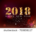2018 on a bright sparkling... | Shutterstock .eps vector #703858117