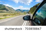 driving view from side of car...   Shutterstock . vector #703858867