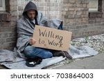 Homeless Man In Hood Sitting O...