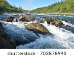 the rapids on a northern river. ... | Shutterstock . vector #703878943