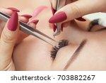 eyelash removal procedure close ...   Shutterstock . vector #703882267