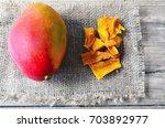 raw organic dried mango and...   Shutterstock . vector #703892977
