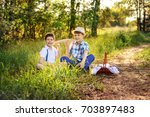 portrait of two boys brothers... | Shutterstock . vector #703897483