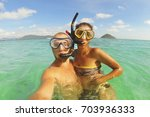 young mixed race couple making... | Shutterstock . vector #703936333