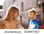 quarrel between young lovers... | Shutterstock . vector #703947307
