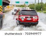 houston  texas   august 27 ... | Shutterstock . vector #703949977