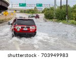 Small photo of Houston, Texas - August 27, 2017: Houston emergency services cars across the flooded feeder street in Houston, Texas, USA. Heavy rains from hurricane Harvey caused many flooded areas in Houston.