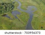 aerial view   wetlands near... | Shutterstock . vector #703956373