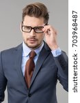 elegant man wear glasses  | Shutterstock . vector #703968487