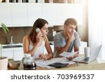 business couple working on... | Shutterstock . vector #703969537
