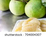 Small photo of Close up many pomelo peeled and pomelo on the table