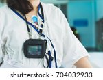 patient wearing holter monitor...   Shutterstock . vector #704032933