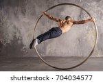 muscular circus performer spin...