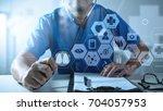 medical technology concept... | Shutterstock . vector #704057953