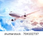 white commercial airplane... | Shutterstock . vector #704102737