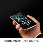 closeup gps navigation on... | Shutterstock . vector #704102773