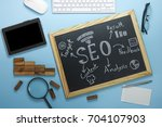 top view of seo search engine... | Shutterstock . vector #704107903