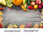 autumn fruits and vegetables on ...   Shutterstock . vector #704108737
