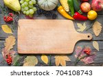 autumn fruits and vegetables on ...   Shutterstock . vector #704108743