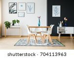 modern dining room designed in... | Shutterstock . vector #704113963