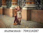 the boy hugs the girl and walks ... | Shutterstock . vector #704114287