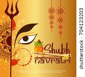 illustration of happy navratri...   Shutterstock .eps vector #704123203
