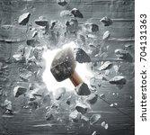 hammer hitting the wall causing ... | Shutterstock . vector #704131363