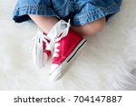 fashionable red sneakers on... | Shutterstock . vector #704147887