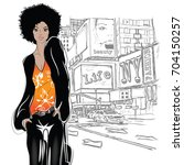 fashion girl in sketch style on ... | Shutterstock .eps vector #704150257