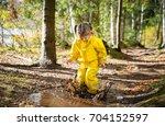 cute little girl jumping in...   Shutterstock . vector #704152597