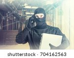 hacker with laptop talking on... | Shutterstock . vector #704162563