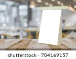 empty brown wooden table and... | Shutterstock . vector #704169157